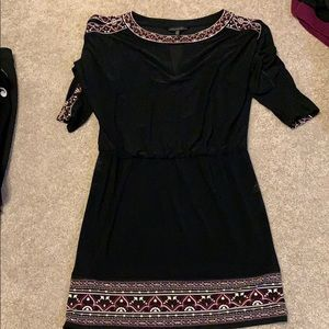 Black dress with detail on sleeves and hem